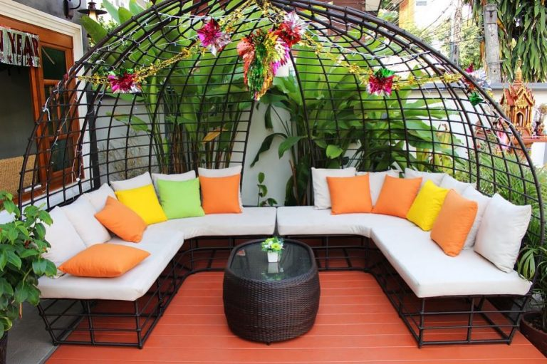 outdoor living -- photo with outdoor seating and trellis with flowers.