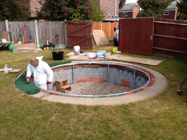 drain system for an in ground trampoline