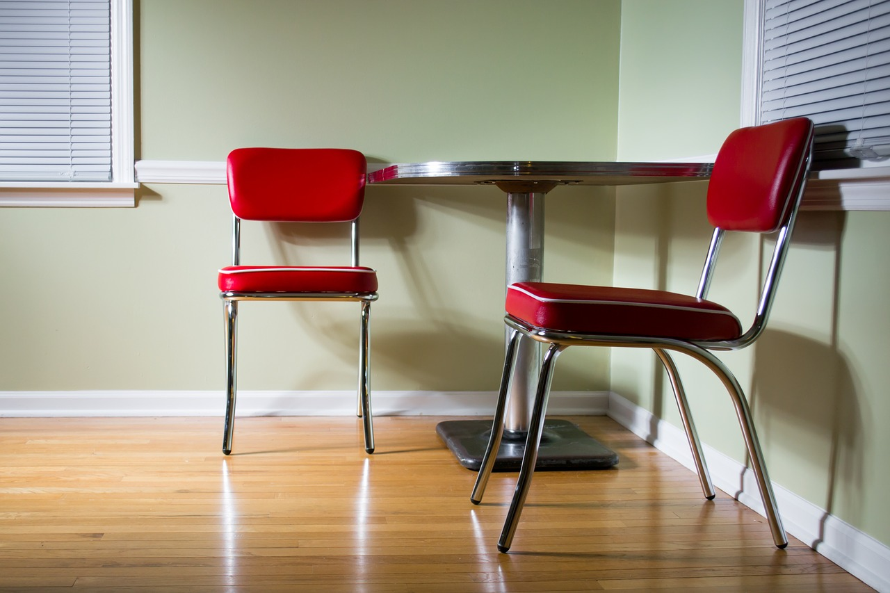 red chairs and table - vinyl flooring