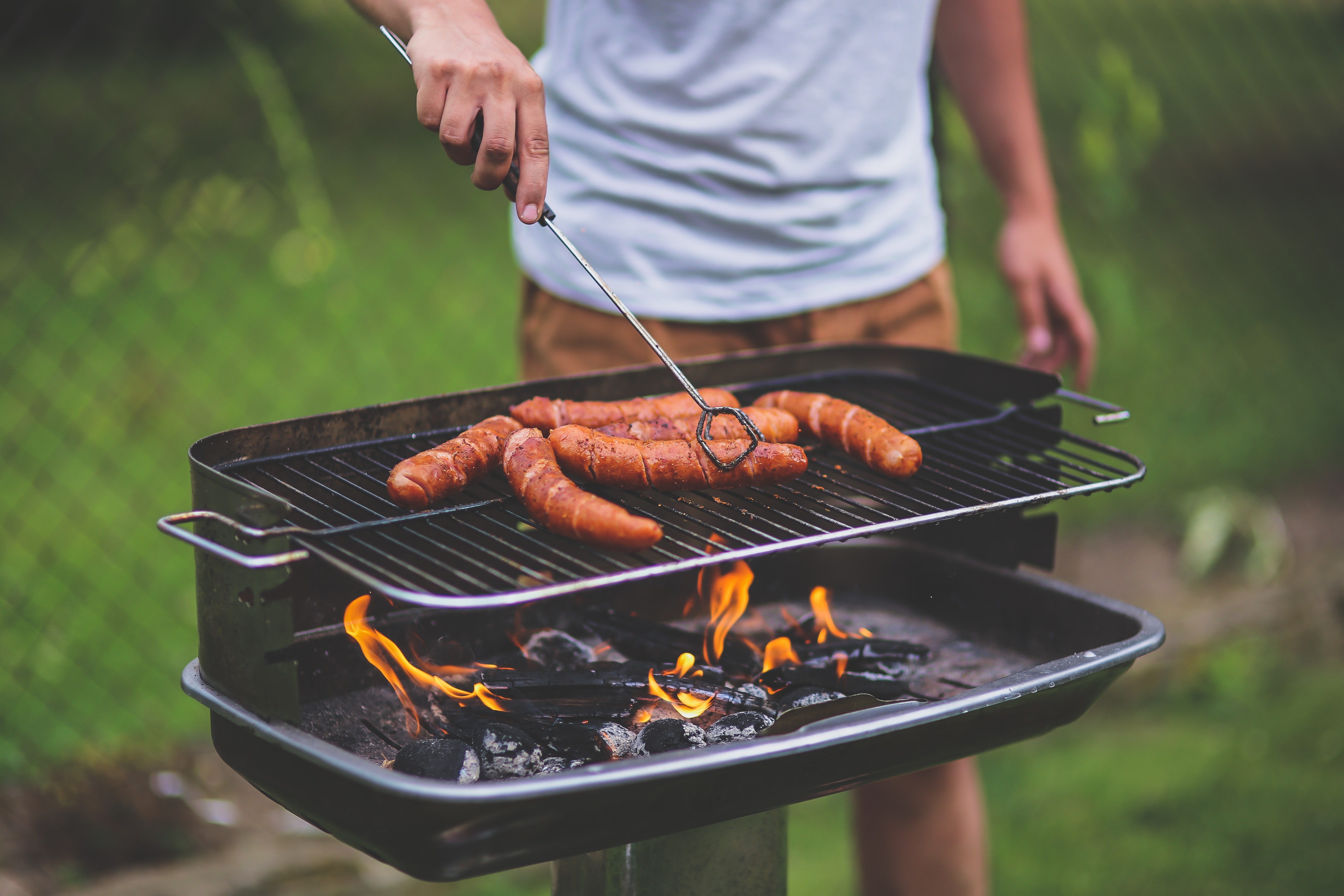 grilling a sausage